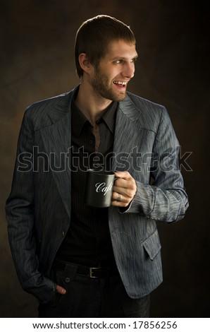 Man drinks the fragrant coffee - stock photo