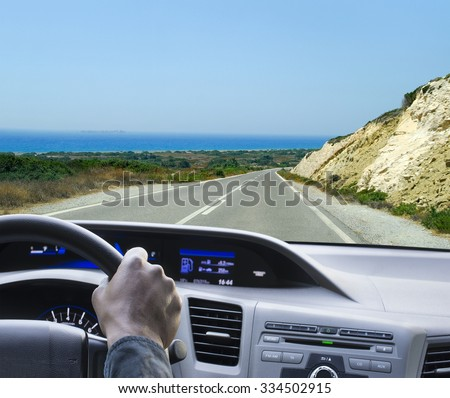 Man driving a car - stock photo