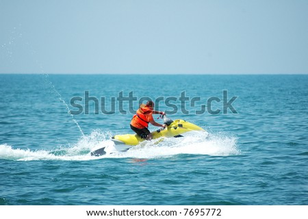 Man driving a motorised scooter at sea