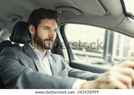 Man driving car - stock photo
