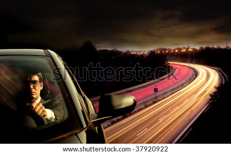 man driving car with highway view on the background