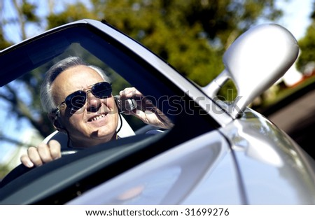 Man driving convertible - stock photo