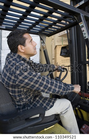 Man driving forklift - stock photo