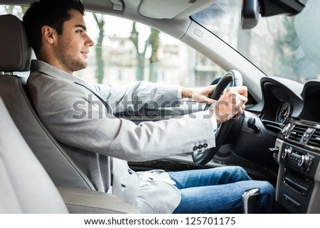 Man driving his car - stock photo