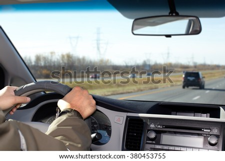 Man driving on a highway.