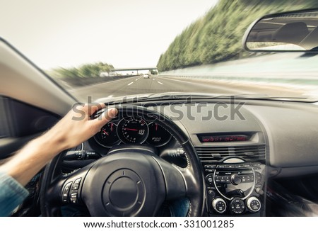 Man driving the car on the freeway in Los Angeles, California. concept about traffic jam,transportation and travels - stock photo