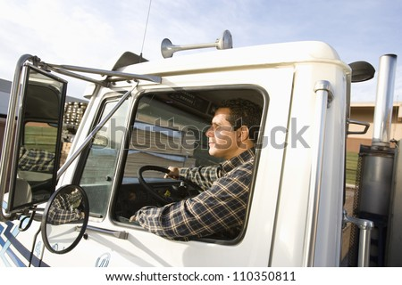 Man driving truck - stock photo