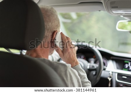 Man driving using smartphone