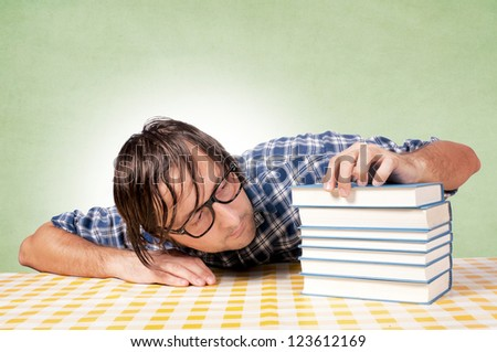 Man drowsiness on books - stock photo