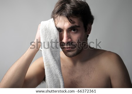 Man drying his sweat with a towel - stock photo