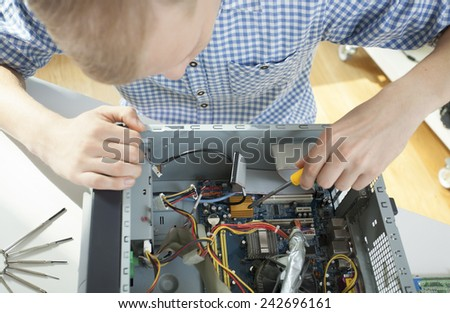 Man during computer reparation - stock photo