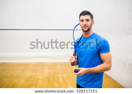 Man eager to play some squash in the squash court - stock photo