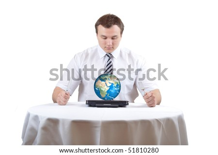 Man eat Earth on notebook as plate on lunch - stock photo