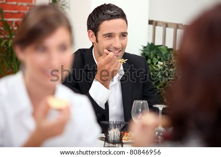 Man eating a meal in a restaurant - stock photo