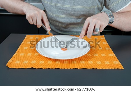 Man eating a piece of carrot - stock photo