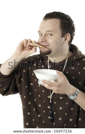 Man eating a piece of meat, isolated on white - stock photo