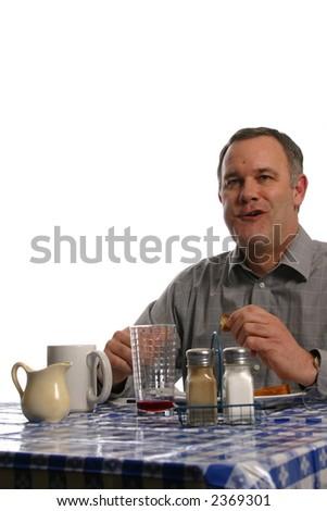Man eating and talking at diner - stock photo