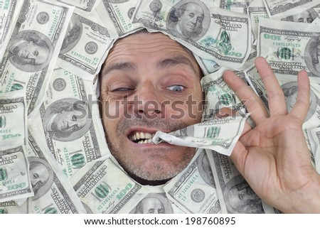 man eating dollar notes. financial concept - stock photo