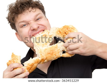 man eats bread on a white background - stock photo