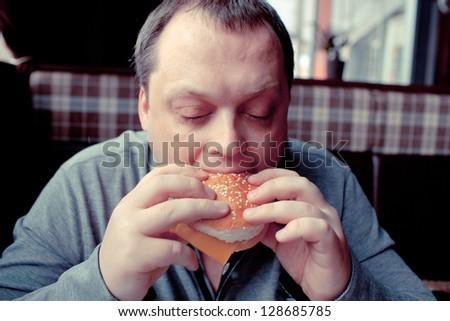 man eats in a restaurant - stock photo