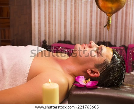 man engaged in Ayurvedic spa treatment - stock photo