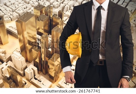 Man engineer and his plastic urban construction - stock photo