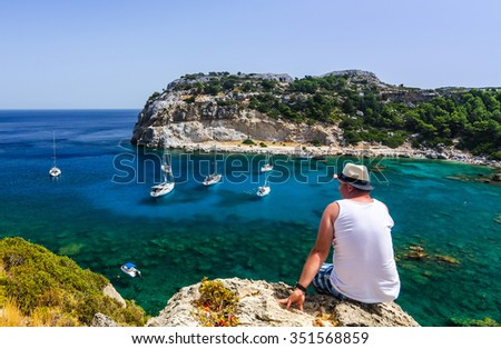 Man enjoy beautiful view for Anthony Quinn sea bay - stock photo