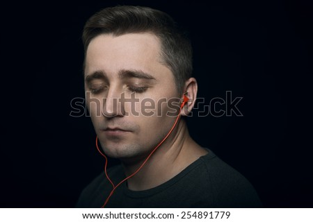 man enjoy music - stock photo