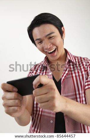 man enjoy playing games on the smartphone - stock photo
