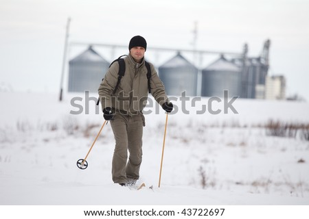 Man enjoying cross-country skiing - stock photo