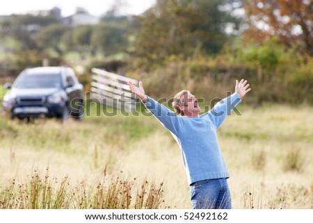 Man Enjoying Freedom Outdoors in Autumn Landscape - stock photo