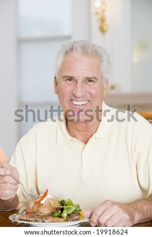 Man Enjoying Healthy meal,mealtime - stock photo