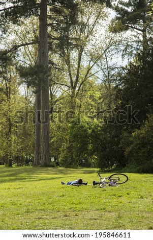 Man enjoying of his free time at  park in a sunny day - stock photo