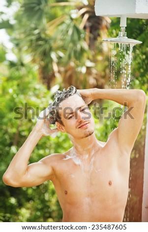 man enjoying washing outdoors - stock photo