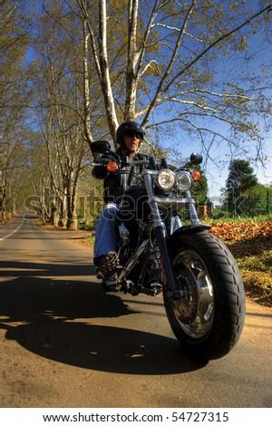 Man enjoys his Sunday afternoon ride on his motorbike - stock photo