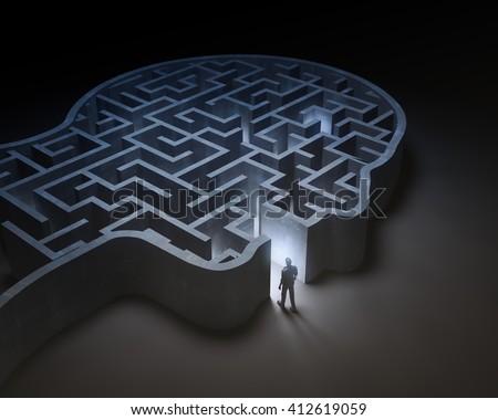 Man entering a maze inside a head - 3D illustration - stock photo
