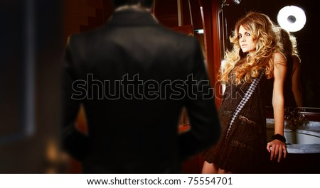 man entering the woman's room - stock photo