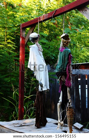 Man executed by hanging in a forest - Halloween decoration in dark colors - stock photo
