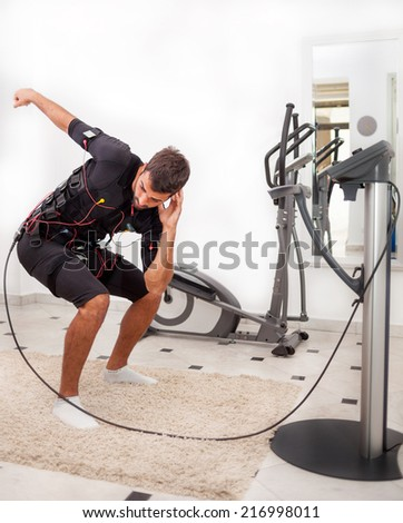 man exercise trunk-bending with twist - stock photo