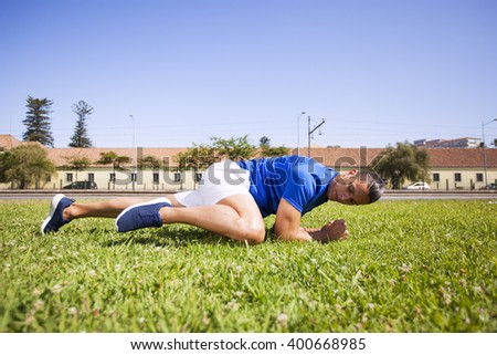 Man exercising with sit ups - stock photo