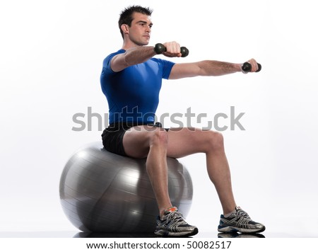 man exercising workout on white background. Seated Swiss Ball Lateral Arm Raise - stock photo