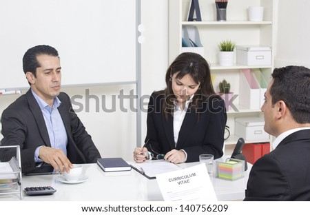 man explaining about her profile to business managers at a job interview - stock photo