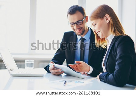 Man explaining something to his young colleague - stock photo