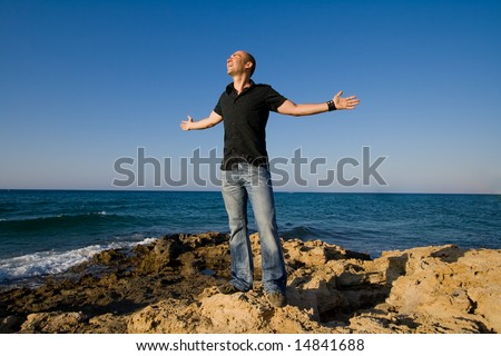 man expressing freedom with his arms wide open - stock photo
