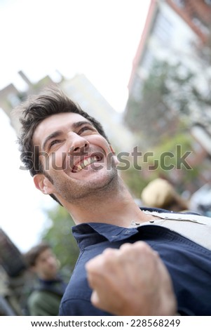 Man expressing happiness and success in the street - stock photo
