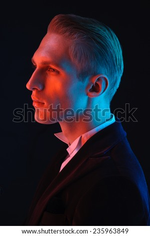 man face close up portrait on dark background - stock photo
