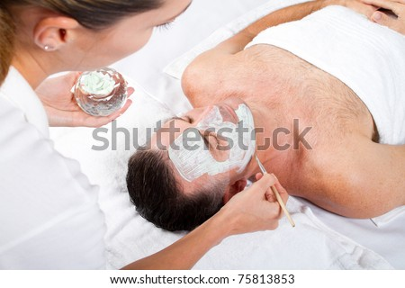 man facial mask in luxury beauty spa - stock photo