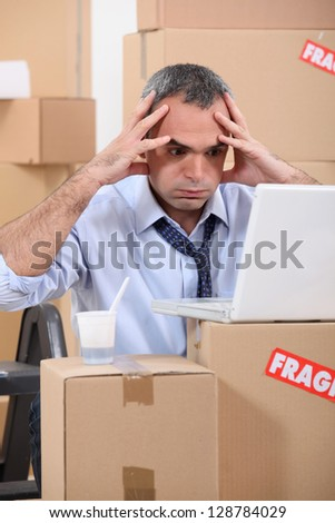 Man facing a logistical nightmare - stock photo