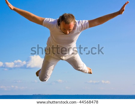 Man falling from the skies - stock photo