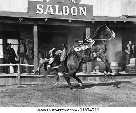 Man falling off horse - stock photo